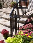 """Traditional"" railing with full lateral scroll."